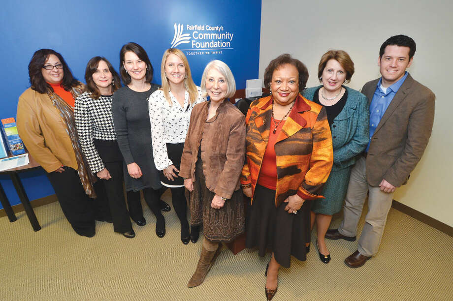 Fairfield County's Community Foundation giving group, from left to right: Marie Prosenti, office administrator, Carloe Schwartz, corporate and foundation relations manager, Elaine Mintz, director, Kristy Jelenik, development manager, Fiona Hodgson, vice president of development and marketing, Juanita James, president & CEO, Carol Heller, senior vice president, market manager enterprise business and community engagement, Bank of America, RJ Mercede M.S., Center for Nonprofit Excellence associate.