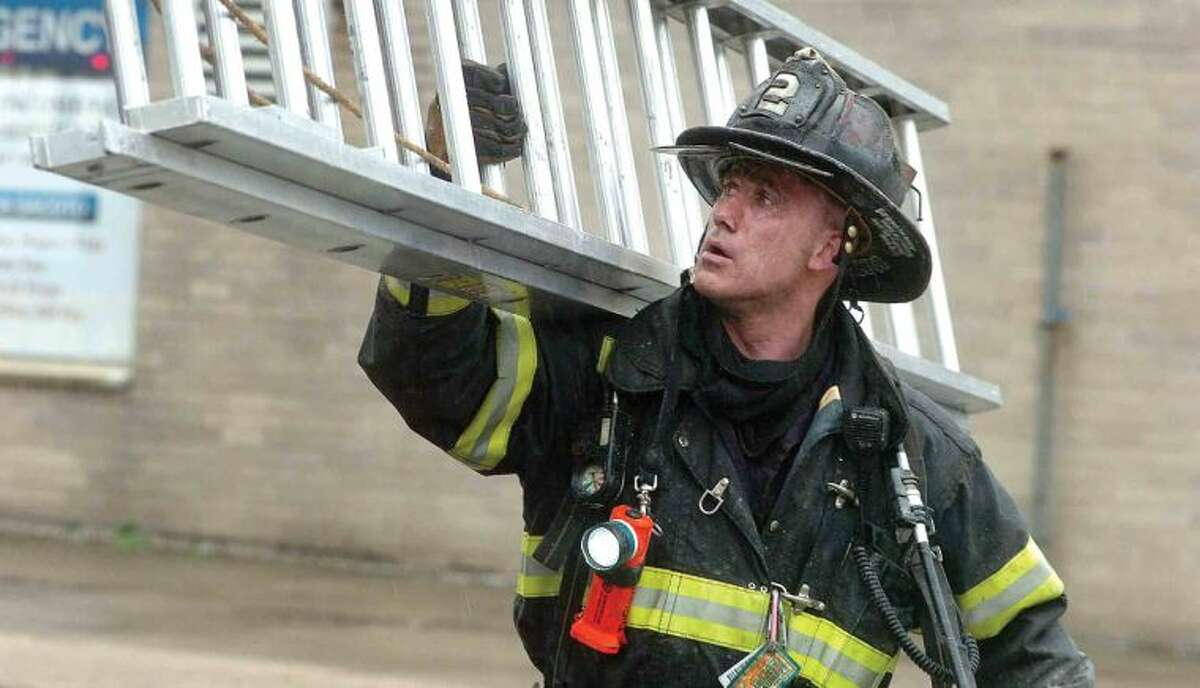 Hour Photo/ Alex von Kleydorff. Firefighters fight a fire in Norwalk