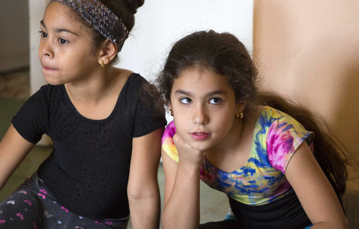 In this Feb. 13, 2016, students attend a dance lesson at the private art workshop Entreartes, in Havana, Cuba. Relatively affluent Cubans say preparing their children for career success is just part of the reason they're sacrificing to pay for private education. Many say it's just as important to raise well-rounded children in a society that's long valued arts and language skills as the measures of an educated person. (AP Photo/Desmond Boylan)