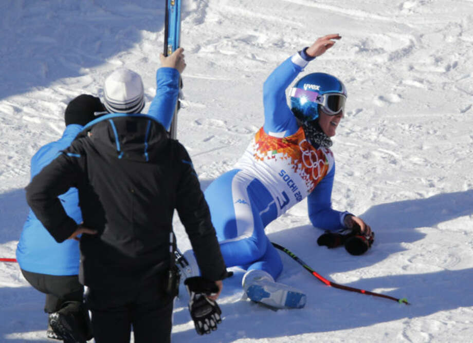 Italy's Daniela Merighetti lies on the snow after finishing a women's downhill training run at the Sochi 2014 Winter Olympics, Thursday, Feb. 6, 2014, in Krasnaya Polyana, Russia. (AP Photo/Christophe Ena)