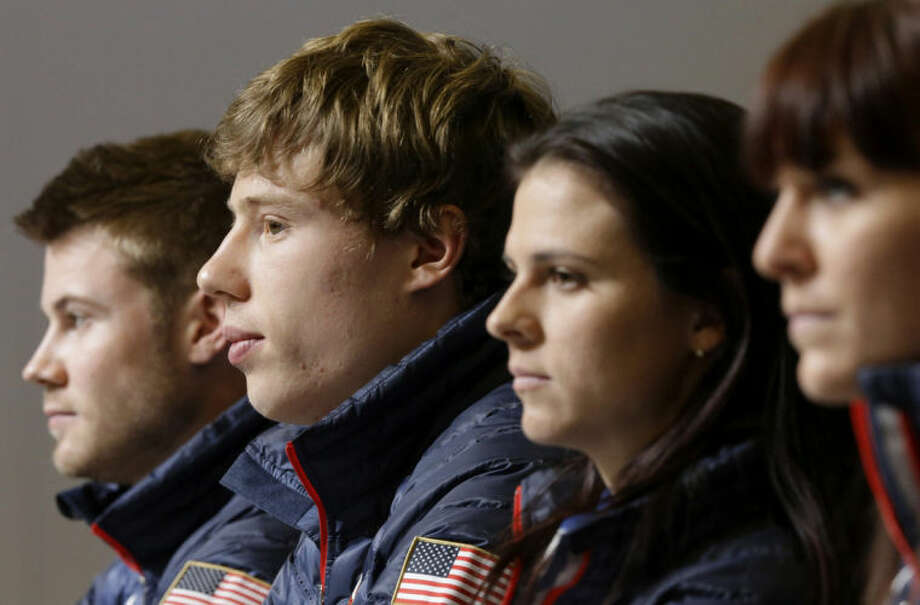 U.S. speedskaters Joey Mantia, from left, Brian Hansen, Brittany Bowe and Heather Richardson listen to a reporter's question during a 2014 Winter Olympics news conference, Thursday, Feb. 6, 2014, in Sochi, Russia. (AP Photo/Patrick Semansky)