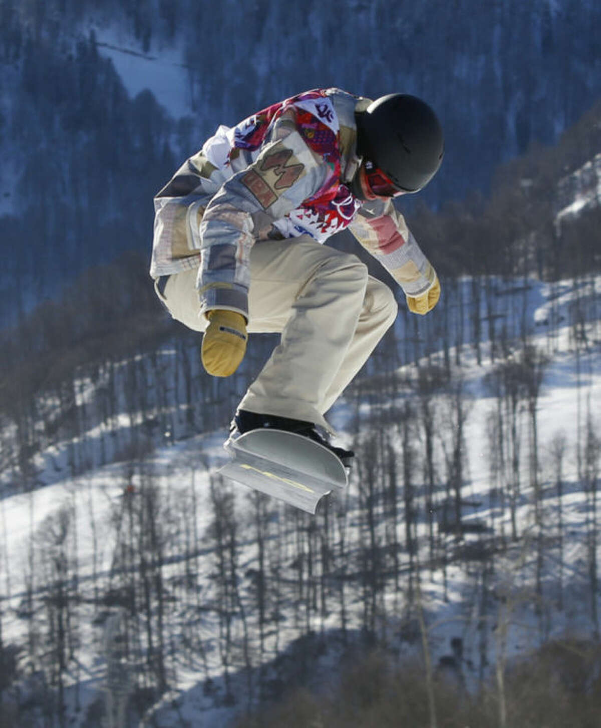 United States' Charles Guldemond takes a jump during men's snowboard slopestyle qualifying at the Rosa Khutor Extreme Park ahead of the 2014 Winter Olympics, Thursday, Feb. 6, 2014, in Krasnaya Polyana, Russia. (AP Photo/Sergei Grits)