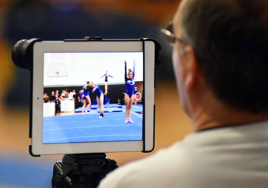 Hour photo/John Nash - Action from Saturday's FCIAC Gymnastics Championship meet at Jonathan Law High School in Milford.
