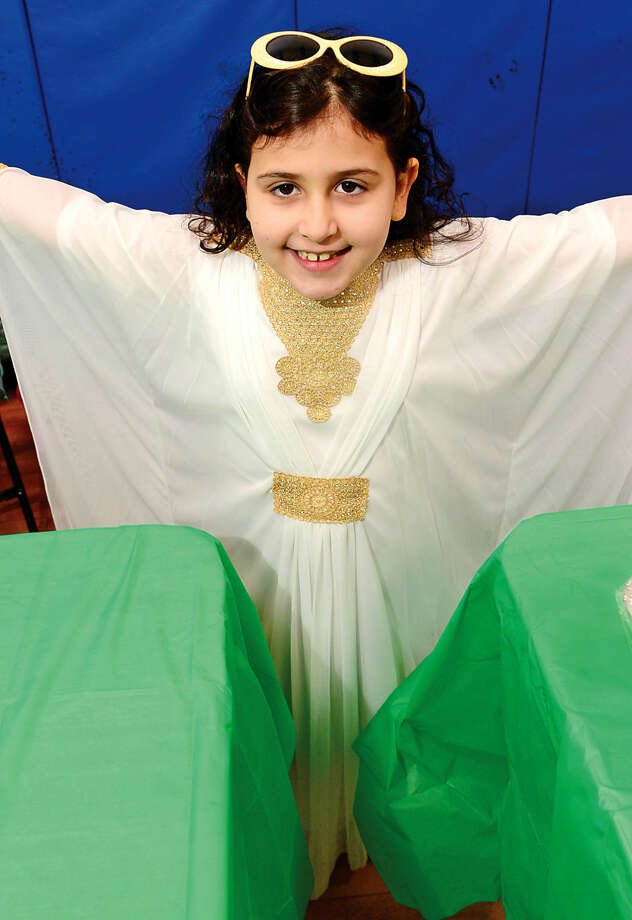K.T. Murphy School first-graders Camilia Amezzane dresses in traditional Moroccan garb during the 6th annual Multiculturism Fair at K.T. Murphy School in Stamford Saturday. The fair featured interactive displays and food tastings from 19 different countries.
