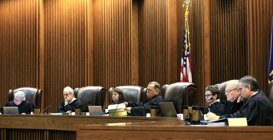 FILE - In this Monday, Dec. 14, 2015 file photo, Kansas Supreme Court Justices prepare to hear arguments in a capital murder case during a session in Topeka, Kan. Republican lawmakers in Kansas are beginning to act on a measure to expand the legal grounds for impeaching judges. The move is part of an intensified effort in red states to reshape courts still dominated by moderate judges from earlier administrations. (AP Photo/Orlin Wagner, File)