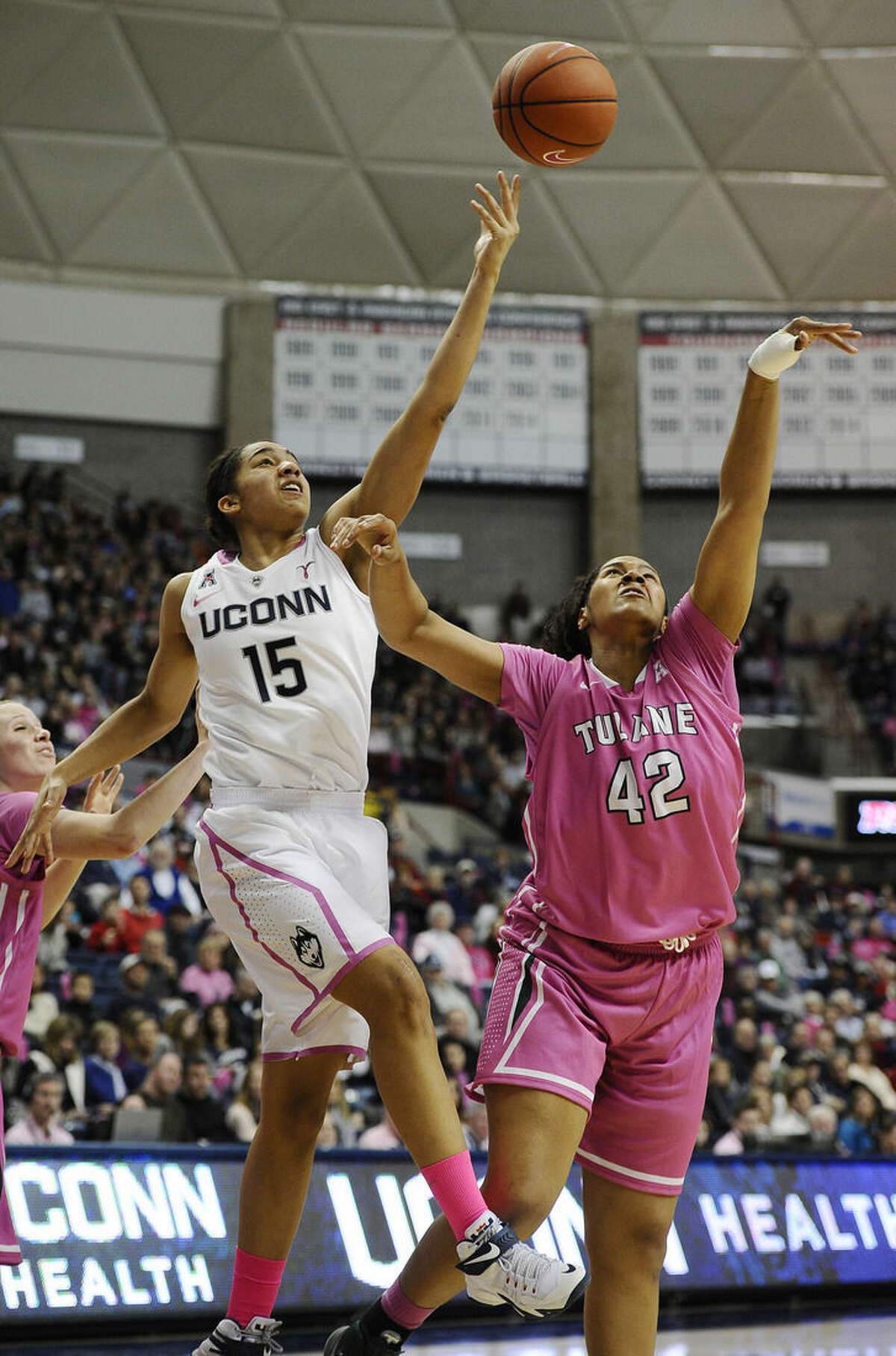 Connecticut's Gabby Williams, left, reaches for a loose ball against Tulane's Morgan Rogers, right, during the second half of an NCAA college basketball game, Saturday, Feb. 14, 2015, in Storrs, Conn. UConn won 87-39. (AP Photo/Jessica Hill)