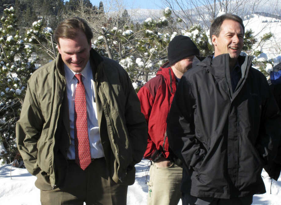 U.S. Department of Agriculture Secretary Robert Bonnie, left, and Montana Gov. Steve Bullock, speak outside the Tenmile Water Treatment Plant in Helena, Mont., on Thursday, Feb. 6, 2014. Restoring the Tenmile watershed is one of 13 projects the USDA announced it would spend $30 million on this year (AP Photo/Matt Volz)