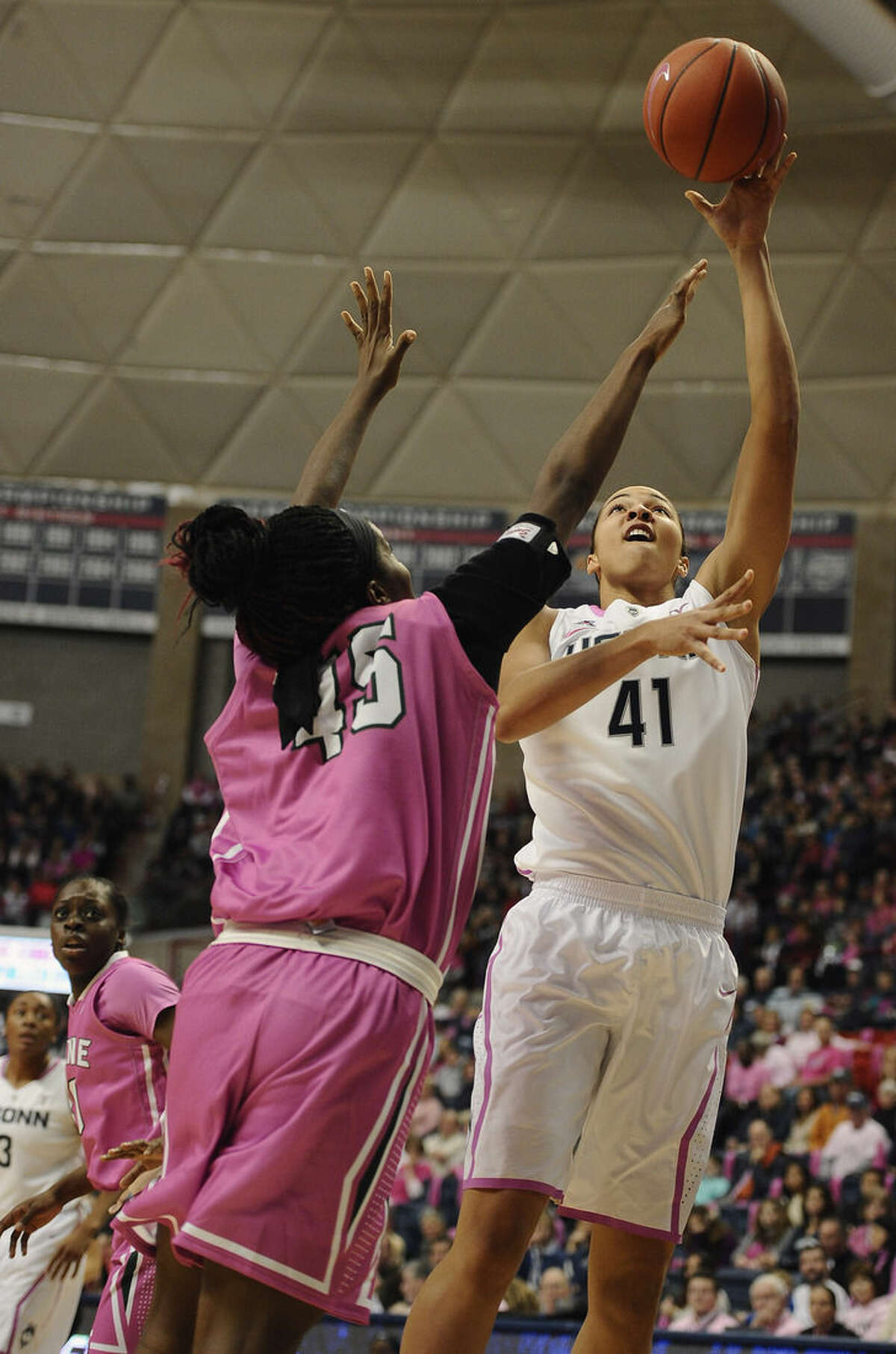 Connecticut's Kiah Stokes, right, shoots over Tulane's Chinwe Duru, left, during the first half of an NCAA college basketball game, Saturday, Feb. 14, 2015, in Storrs, Conn. (AP Photo/Jessica Hill)