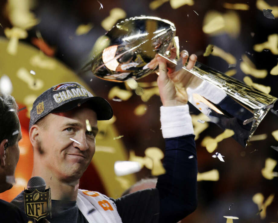 FILE - In this Feb. 7, 2016, file photo, Denver Broncos' Peyton Manning holds up the trophy after the NFL Super Bowl 50 football game in Santa Clara, Calif. A person with knowledge of the decision tells The Associated Press on Sunday, March 6, 2016, that Manning has informed the Denver Broncos he's going to retire. The person, who was briefed on the matter, spoke to The AP on condition of anonymity because the quarterback and the team were still working out details of an announcement. (AP Photo/Matt York, File)