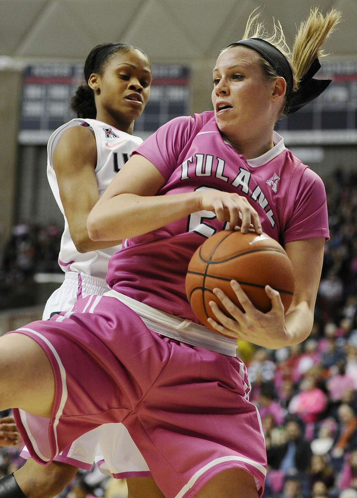 Tulane's Danielle Blagg pulls down a rebound in front of Connecticut's Moriah Jefferson during the first half of an NCAA college basketball game, Saturday, Feb. 14, 2015, in Storrs, Conn. UConn won 87-39. (AP Photo/Jessica Hill)