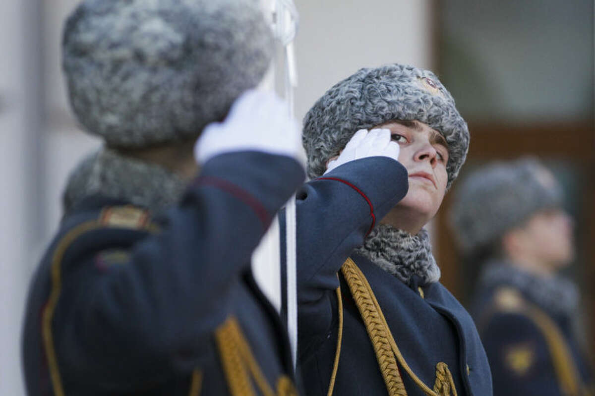 Members of the Russian honor guard salute during a welcome ceremony for the Austrian Olympic team at the Mountain Olympic Village prior to the 2014 Winter Olympics, Thursday, Feb. 6, 2014, in Krasnaya Polyana, Russia. (AP Photo/Jae C. Hong)