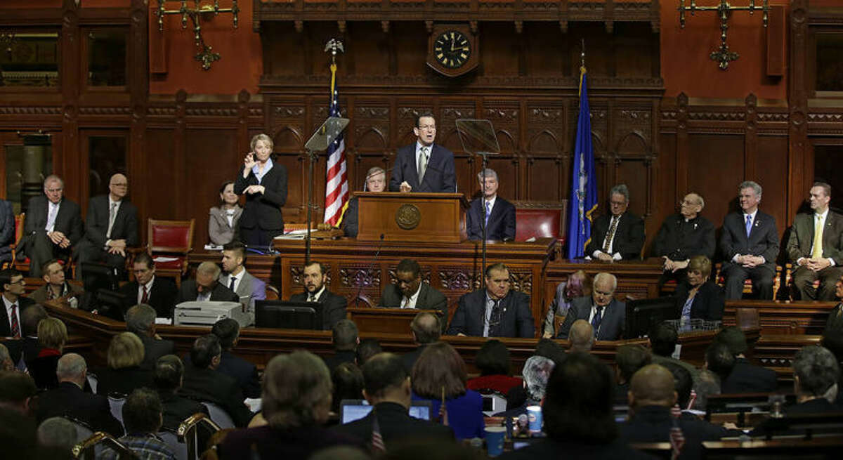 AP photo / Stephan Savoia Connecticut Gov. Dannel P. Malloy gestures as he emphasizes a point during his 2014 State of the State address in front of a joint session of the legislature in the House Chambers at the Capitol in Hartford, Thursday.