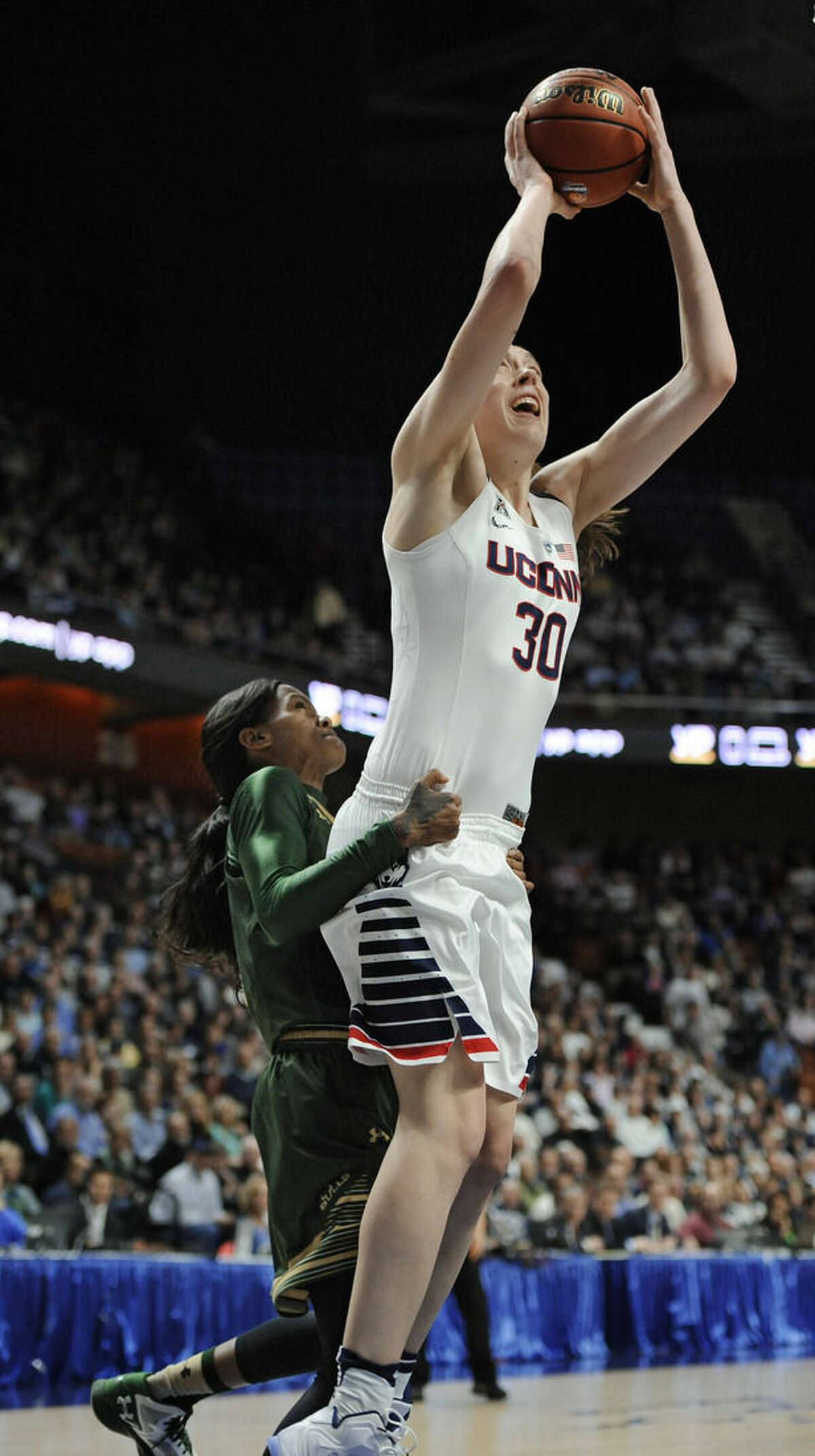 South Florida's Courtney Williams, back fouls Connecticut's Breanna Stewart during the first half of an NCAA college basketball game in the American Athletic Conference tournament finals at Mohegan Sun Arena, Monday, March 7, 2016, in Uncasville, Conn. (AP Photo/Jessica Hill)