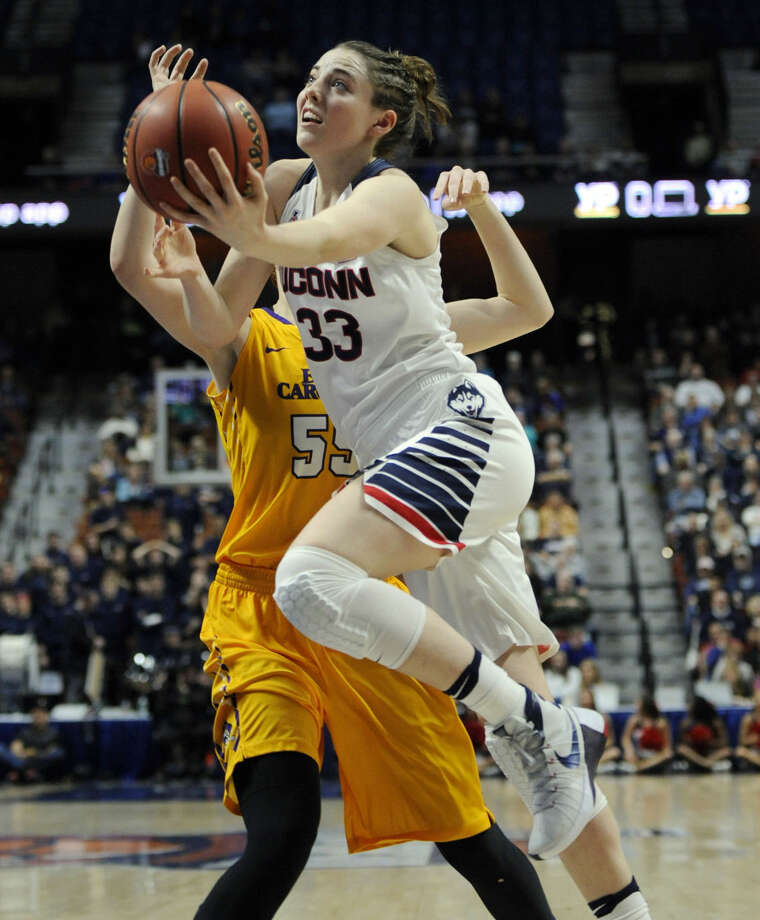 Connecticut's Katie Lou Samuelson drives to the basket around East Carolina's Marina Laramie, back, during the first half of an NCAA college basketball game in the American Athletic Conference tournament quarterfinals at Mohegan Sun Arena, Saturday, March 5, 2016, in Uncasville, Conn. (AP Photo/Jessica Hill)