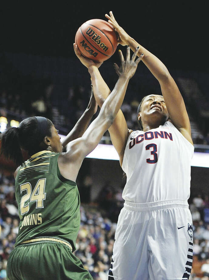 AP photoUConn's Morgan Tuck shoots as South Florida's Alisia Jenkins defends during the first half of Monday's championship game in the American Athletic Conference tournament at Mohegan Sun Arena in Uncasville.