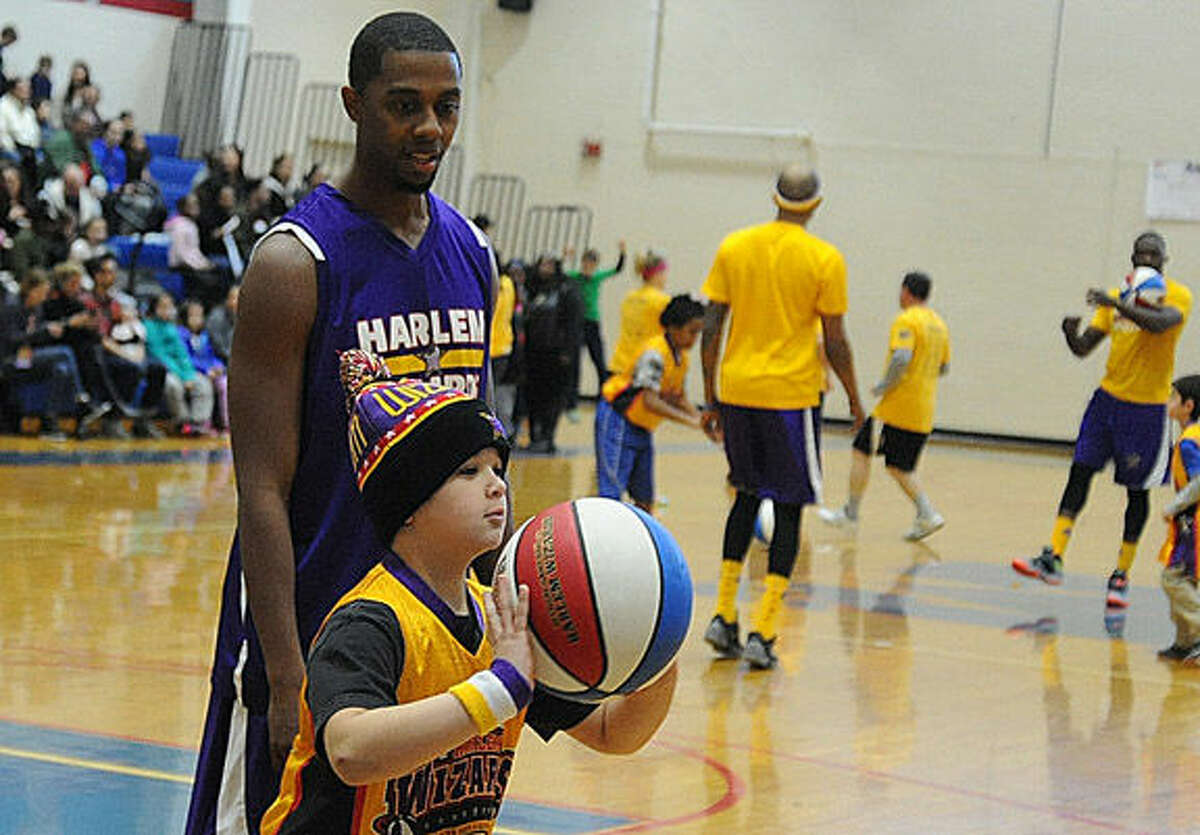 Fun with kids Sunday when the Harlem Wizards visited Brien McMahon High School in Norwalk. Hour photo/Matthew Vinci