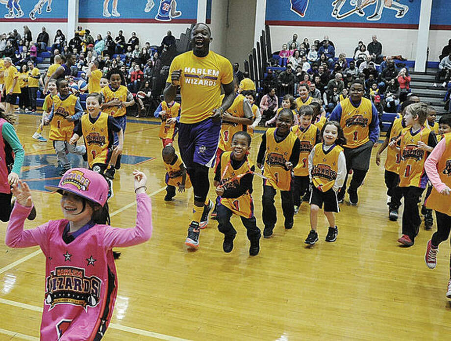 "Jordan ""Flight"" Southerland of the Harlem Wizards works out with kids Sunday when the Wizards visited Brien McMahon High School in Norwalk. Hour photo/Matthew Vinci"