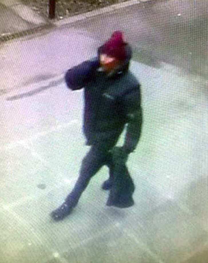 In this photo dated Saturday Feb. 14, 2015, issued by Copenhagen Police believed to show the suspect in a shooting at a freedom of speech event in Copenhagen, in a photo taken from a street camera near to where the getaway car was later found dumped. In what is seen as a likely terror attack against a free speech event organized by an artist who had caricatured the Prophet Muhammad, the police believe there was only one shooter in the attack on a Copenhagen cafe that left one person dead and three police officers wounded. (AP Photo /Copenhagen Police) DENMARK OUT - NO SALES