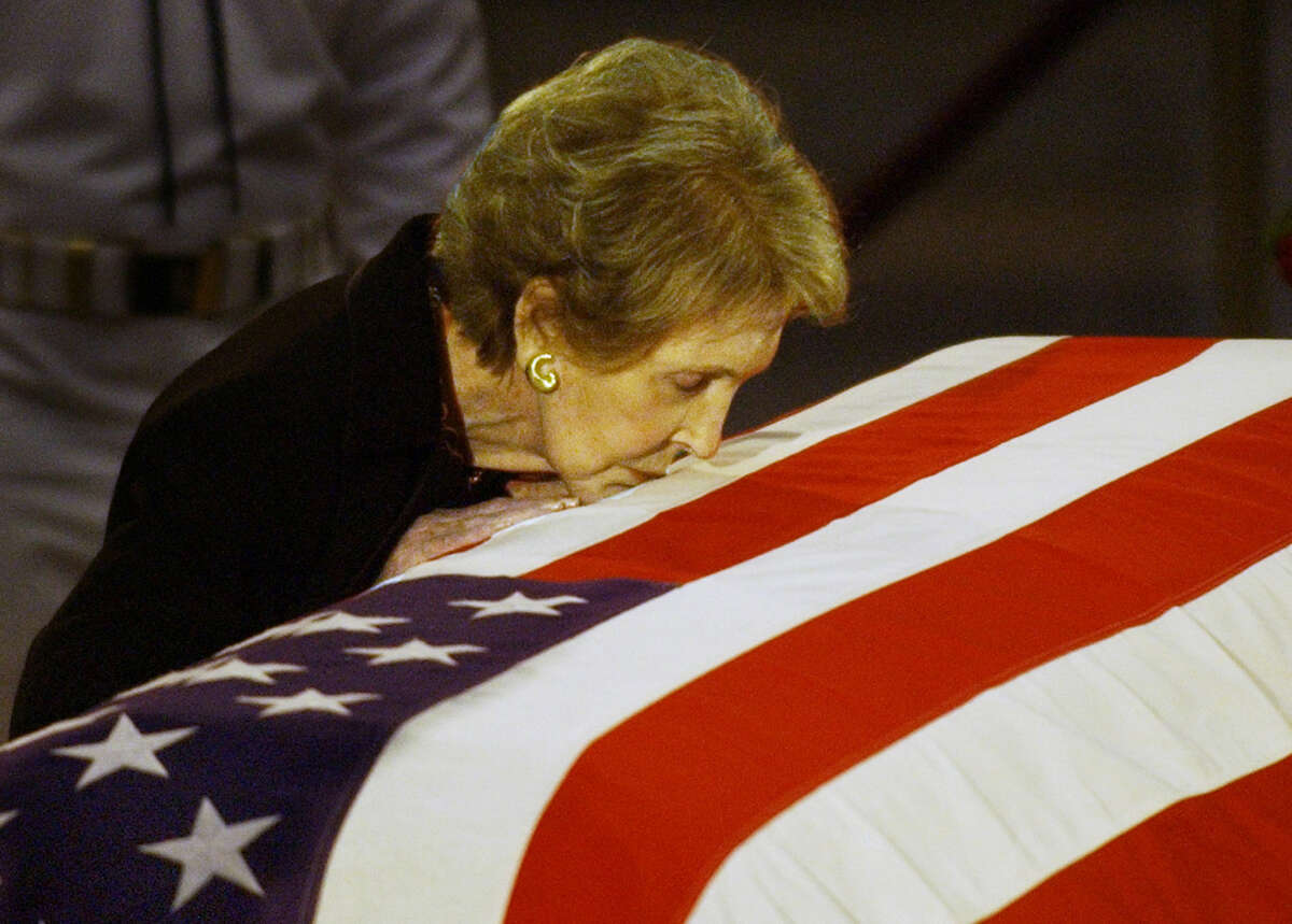 FILE - In this June 11, 2004, file photo, former first lady Nancy Reagan kisses the casket of her husband former President Ronald Reagan prior to the removal of his remains from the Capitol Rotunda in Washington. The former first lady has died at 94, The Associated Press confirmed Sunday, March 6, 2016. (AP Photo/Elise Amendola, File)