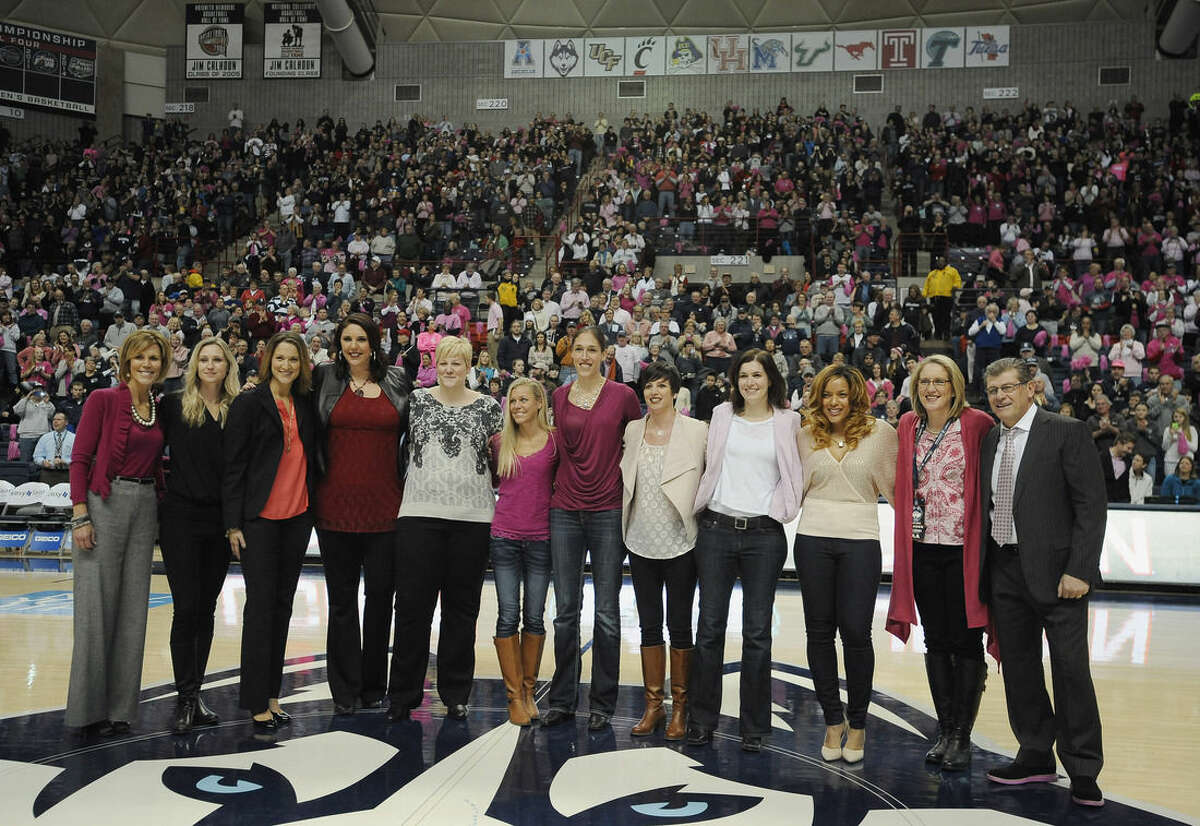 Members of the 1994-95 Connecticut women's basketball team are honored during halftime of an NCAA college basketball game against Tulane, Saturday, Feb. 14, 2015, in Storrs, Conn, to honor the 20th anniversary of Connecticut's first national championship. (AP Photo/Jessica Hill)