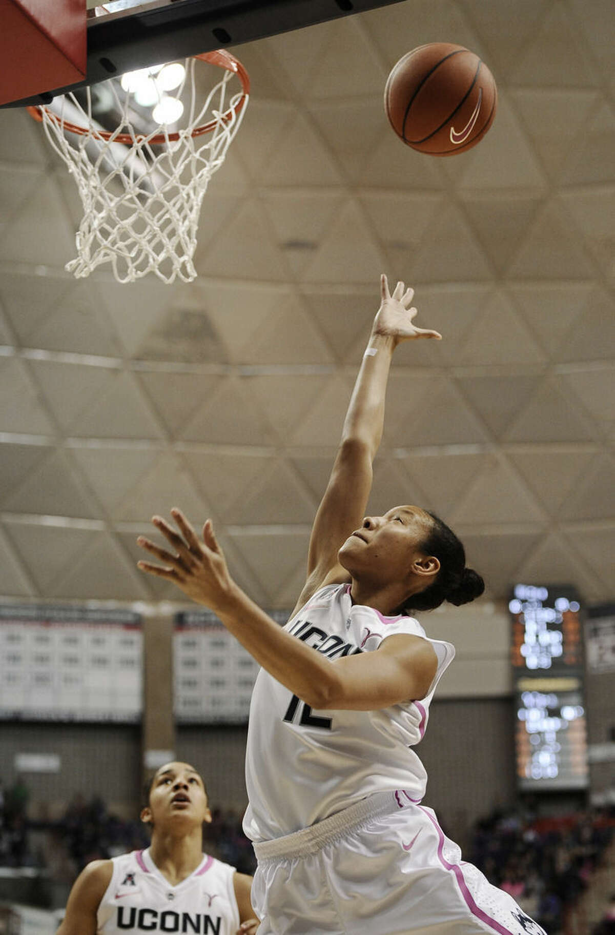 Connecticut's Saniya Chong shoots a basket during the second half of an NCAA college basketball game against Tulane, Saturday, Feb. 14, 2015, in Storrs, Conn. UConn won 87-39. (AP Photo/Jessica Hill)