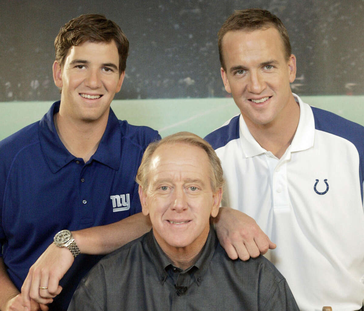 FILE - In this May 8, 2008, file photo, Archie Manning, center, is joined by his sons Eli Manning, left, and Peyton Manning, in Beverly Hills, Calif. A person with knowledge of the decision tells The Associated Press on Monday, March 6, 2016, that Peyton Manning has informed the Denver Broncos he's going to retire. (AP Photo/Reed Saxon, File)