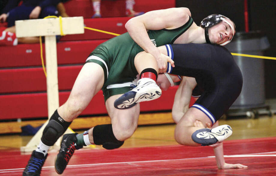 Hour photos/Erik TrautmannAbove, Connor Halloran of Norwalk puts his opponent to the mat during his 160-pound wrestle-back match at Saturday's FCIAC championship meet in New Canaan. Halloran placed fifth in his weight class. At right, Wilton's Finn McGovern, bottom, got out of this precarious situation to defeat Zach Taylow of Ludlowe in their 99-pound weight class semifinal match.