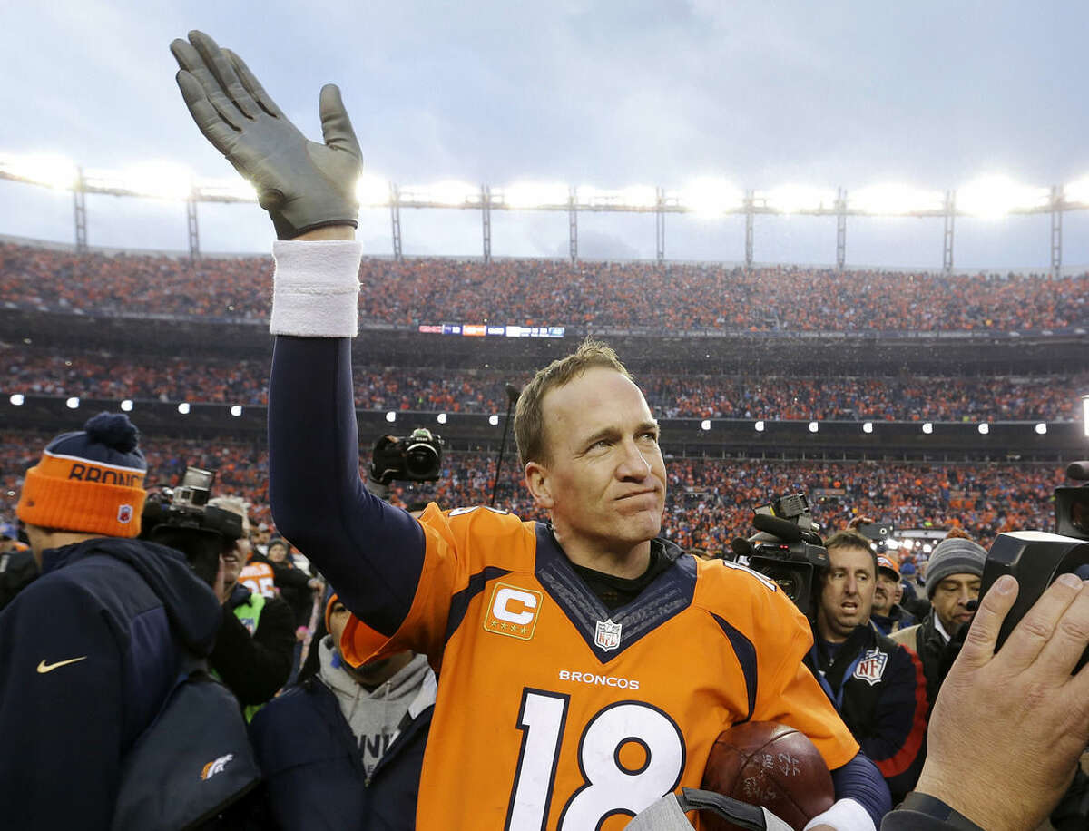 FILE - In this Jan. 24, 2016, file photo, Denver Broncos quarterback Peyton Manning waves to spectators following the AFC Championship game between the Denver Broncos and the New England Patriots, in Denver. A person with knowledge of the decision tells The Associated Press on Sunday, March 6, that Manning has informed the Denver Broncos he's going to retire. (AP Photo/Chris Carlson, File)