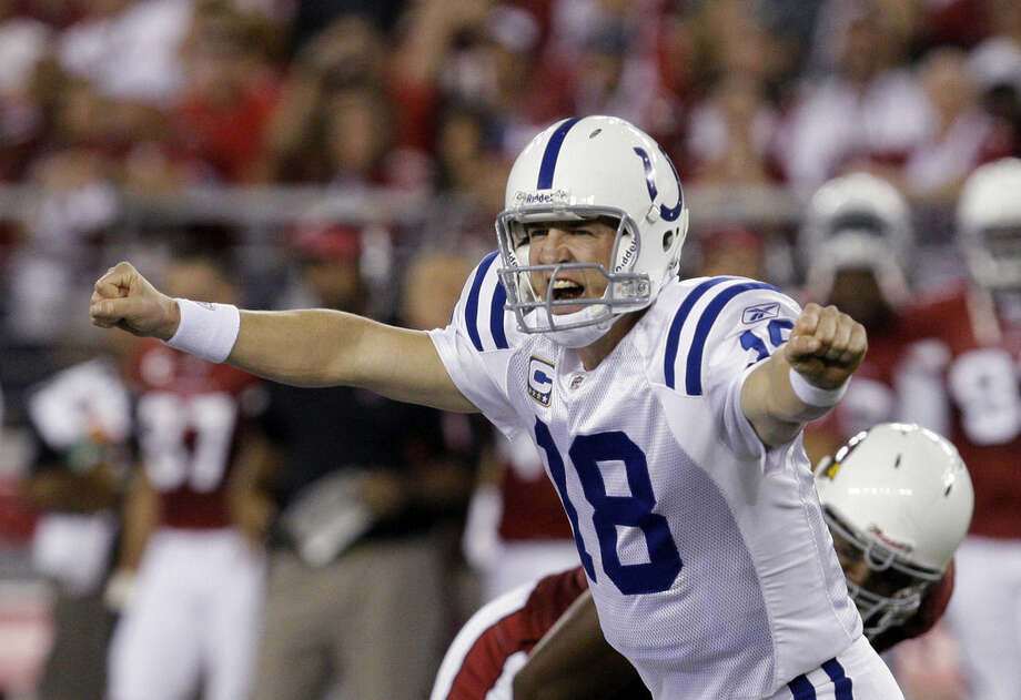 FILE - In this Sept. 27, 2009, file photo, Indianapolis Colts' Peyton Manning shouts signals to teammates as they play the Arizona Cardinals in the second quarter of a football game in Glendale, Ariz. A person with knowledge of the decision tells The Associated Press on Sunday, March 6, 2016, that Manning has informed the Denver Broncos he's going to retire. (AP Photo/Ross D. Franklin, File)