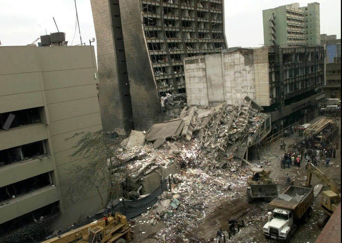 FILE - In this Aug. 8, 1998 file photo, the United States Embassy, left, and other damaged buildings in downtown Nairobi, Kenya, are shown on the day after it was bombed by terrorists. For the past three weeks, Khaled al-Fawwaz, a man portrayed by prosecutors as a key player in al-Qaida when it was in its infancy, has been on trial in New York for his part in the 1998 bombings of two American embassies in Africa. (AP Photo/Dave Caulkin, File)