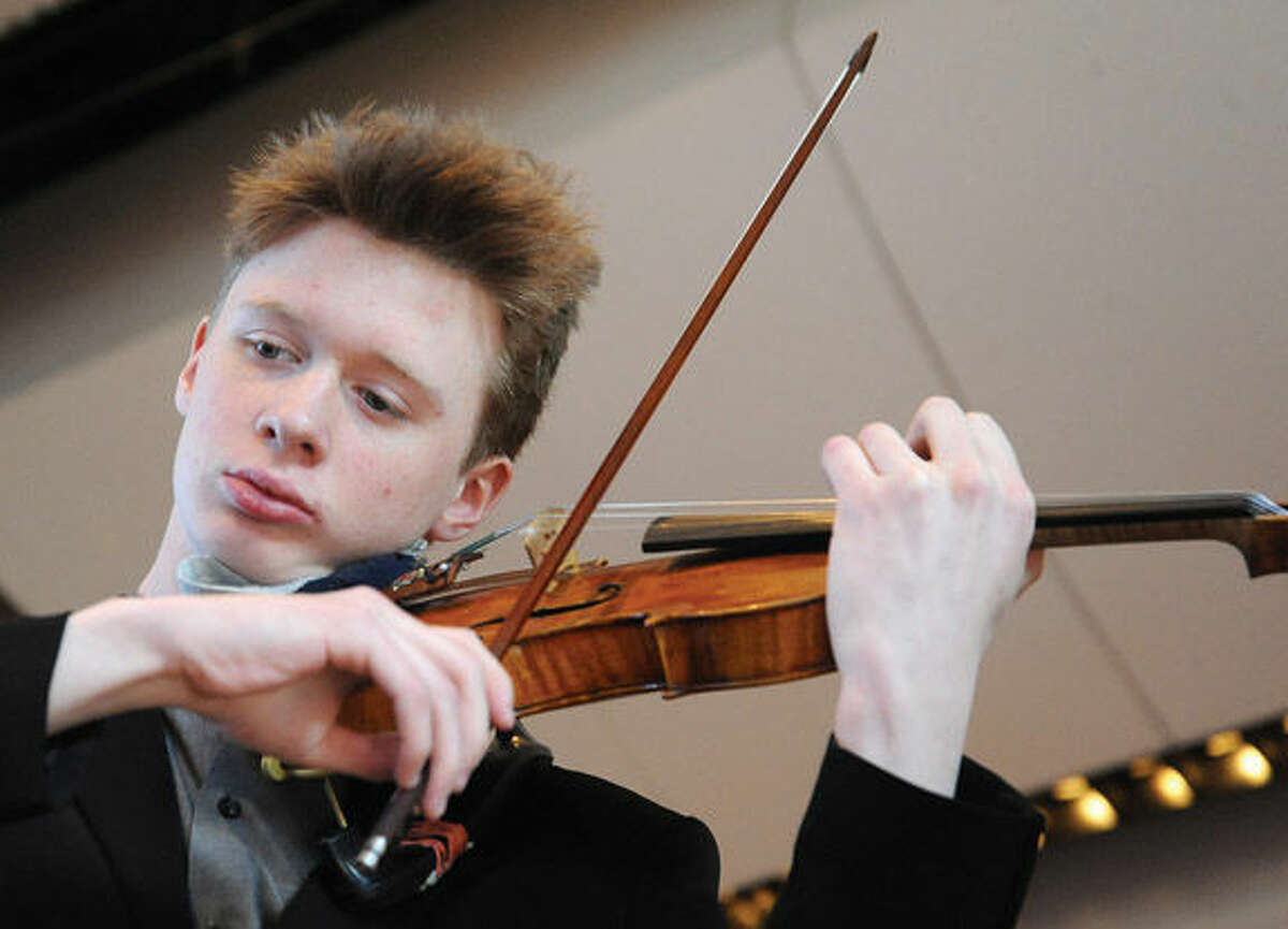 Cameron Chase on the violin Sunday at the Norwalk Symphony Orchestra family concert. Cameron is the Norwalk Symphony Orchestra's 4th Young Artist Competition Winner. Hour photo/Matthew Vinci