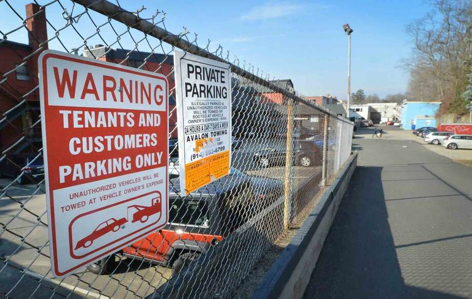 Hour Photo/Alex von Kleydorff Warning Signs along the fence that leads to the parking lot at Landmark Square in Norwalk