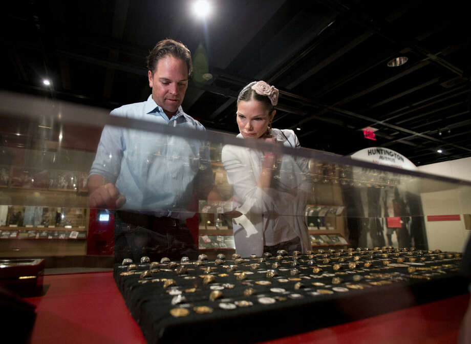 Baseball Hall of Fame electee Mike Piazza and wife Alicia look at a collection of World Series rings during his orientation tour at the hall on Tuesday, March 8, 2016, in Cooperstown, N.Y. Piazza will be inducted in July. (AP Photo/Mike Groll)