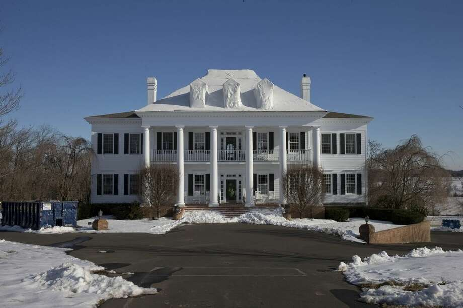 """FILE - In this Wednesday, Feb. 11, 2015 photo shows the mansion called """"Clairemont,"""" in New Hope, Pa. Three fires in five years at the home of the local Republican fundraiser Claire Risoldi and her family, have led to $20 million in insurance payouts as well as sweeping fraud charges against Risoldi, her family members and others. Risoldi has called the case politically motivated, while her husband, former sheriff's deputy Thomas French, left a suicide note saying he committed no crimes. (AP Photo/Matt Rourke)"""