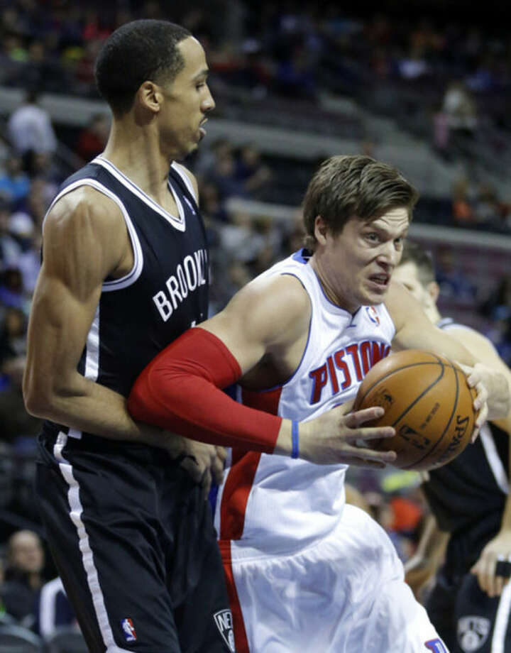 Detroit Pistons forward Jonas Jerebko, right, of Sweden, drives to the basket against Brooklyn Nets guard Shaun Livingston during the first half of an NBA basketball game on Friday, Feb. 7, 2014, in Auburn Hills, Mich. (AP Photo/Duane Burleson)