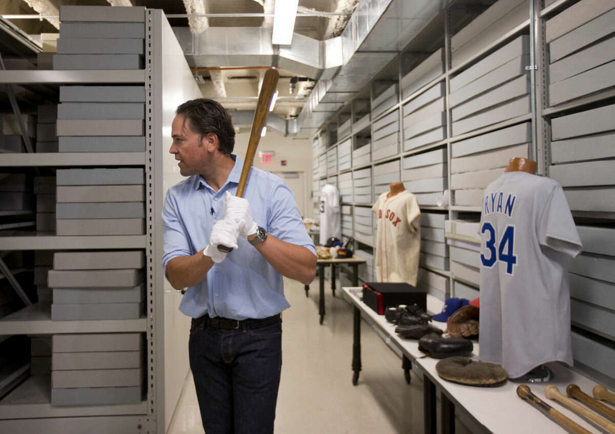 Baseball Hall of Fame electee Mike Piazza holds a bat used by Babe Ruth during his orientation tour at the hall on Tuesday, March 8, 2016, in Cooperstown, N.Y. Piazza will be inducted in July. (AP Photo/Mike Groll)