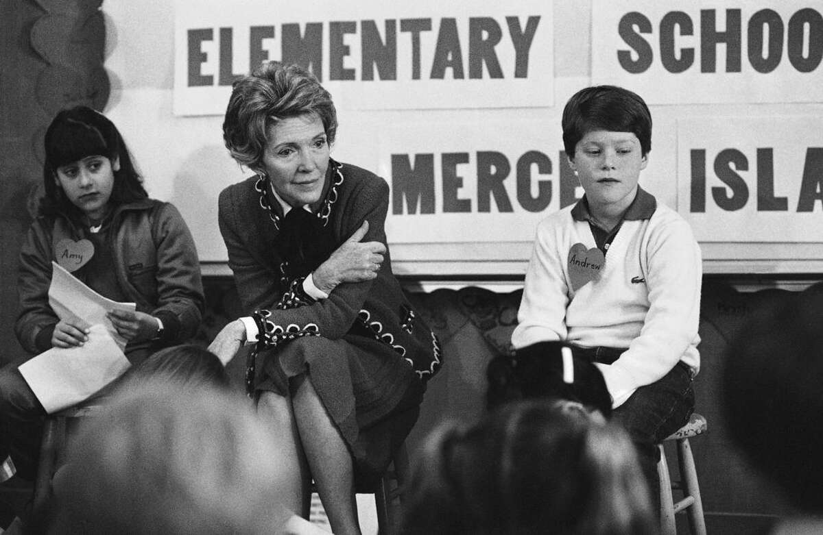 FILE - In this Feb. 14, 1984 file photo, first lady Nancy Reagan sits with fourth- and fifth-graders at Island Park Elementary School on Mercer Island, Wash., where she participated in a drug education class. Reagan, who died Sunday, March 6, 2016, is perhaps best known for her
