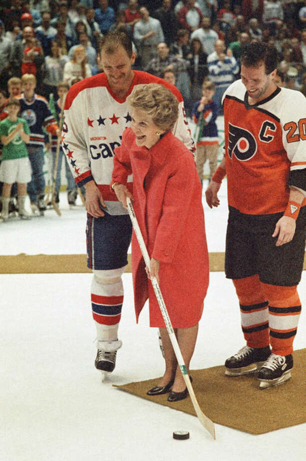 "FILE - In this March 25, 1988 file photo, then first lady Nancy Reagan kicks off the NHL's ""Just Say No"" campaign to help overcome drug abuse among young people, with the help of Washington Capitals captain Red Langway and Philadelphia Fliers captain Dave Poulin, before a hockey game in Landover, Md. Reagan, who died Sunday, March 6, 2016, is perhaps best known for her ""Just Say No"" to drugs and alcohol campaign. Three decades after the campaign's heyday, prevention experts credit it with spawning a new generation of research into the best ways of reducing drug abuse. But they also say that many of the fear-based tactics it embraced didn't work.(AP Photo/C.W. Agel II, File)"
