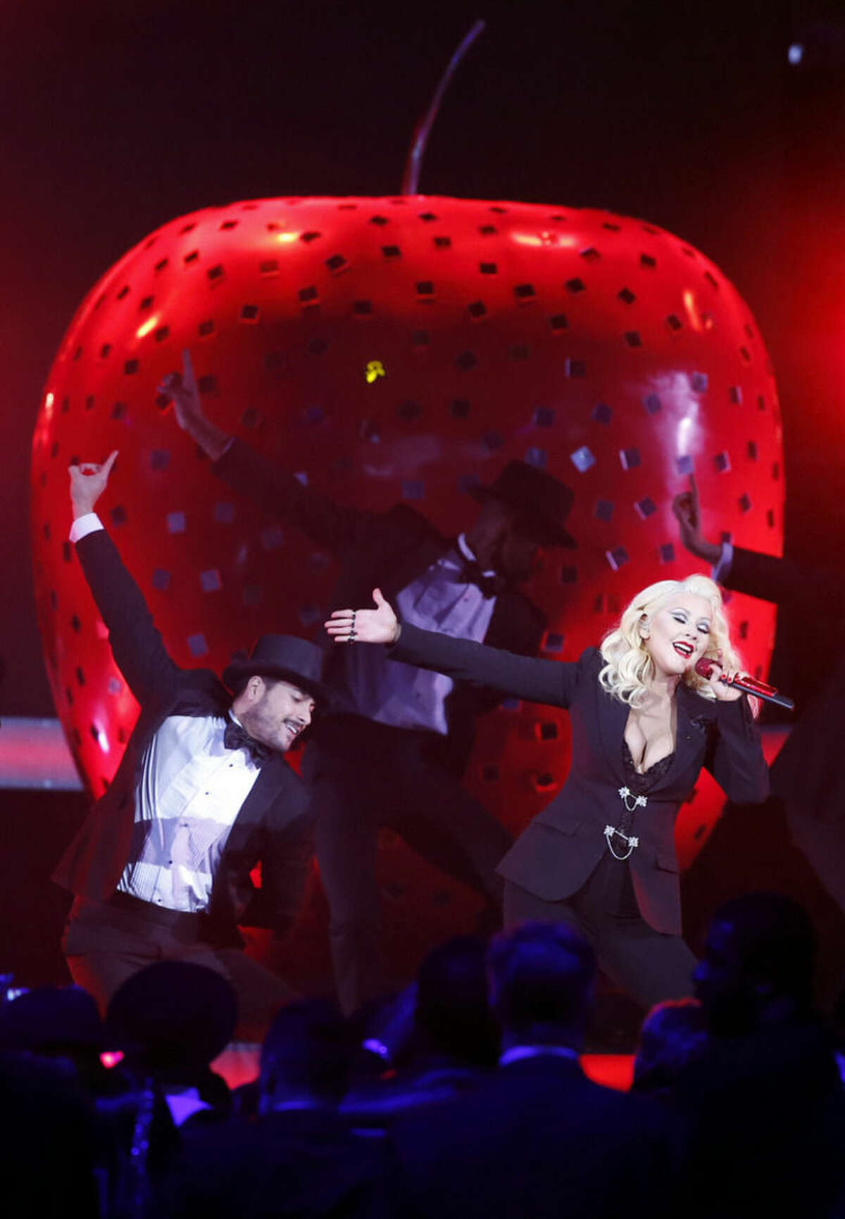 Christina Aguilera performs prior to the start of the NBA All-Star basketball game, Sunday, Feb. 15, 2015, in New York. (AP Photo/Kathy Willens)