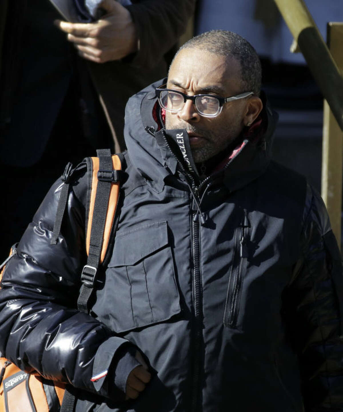 Movie director Spike Lee leaves the Church of St. Ignatius Loyola following the funeral for actor Philip Seymour Hoffman, Friday, Feb. 7, 2014 in New York. Hoffman, 46, was found dead Sunday of an apparent heroin overdose. (AP Photo/Mark Lennihan)