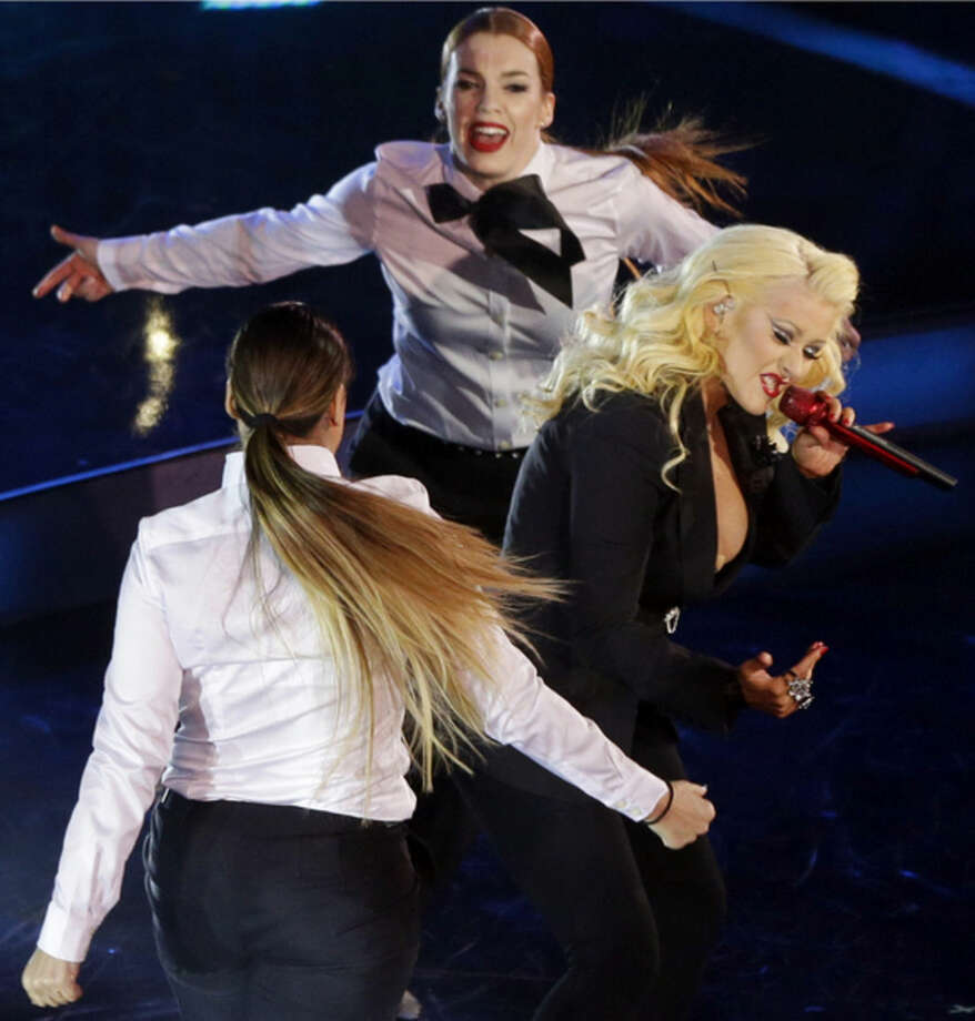 Christina Aguilera performs before the NBA All-Star basketball game, Sunday, Feb. 15, 2015, in New York. (AP Photo/Frank Franklin II)