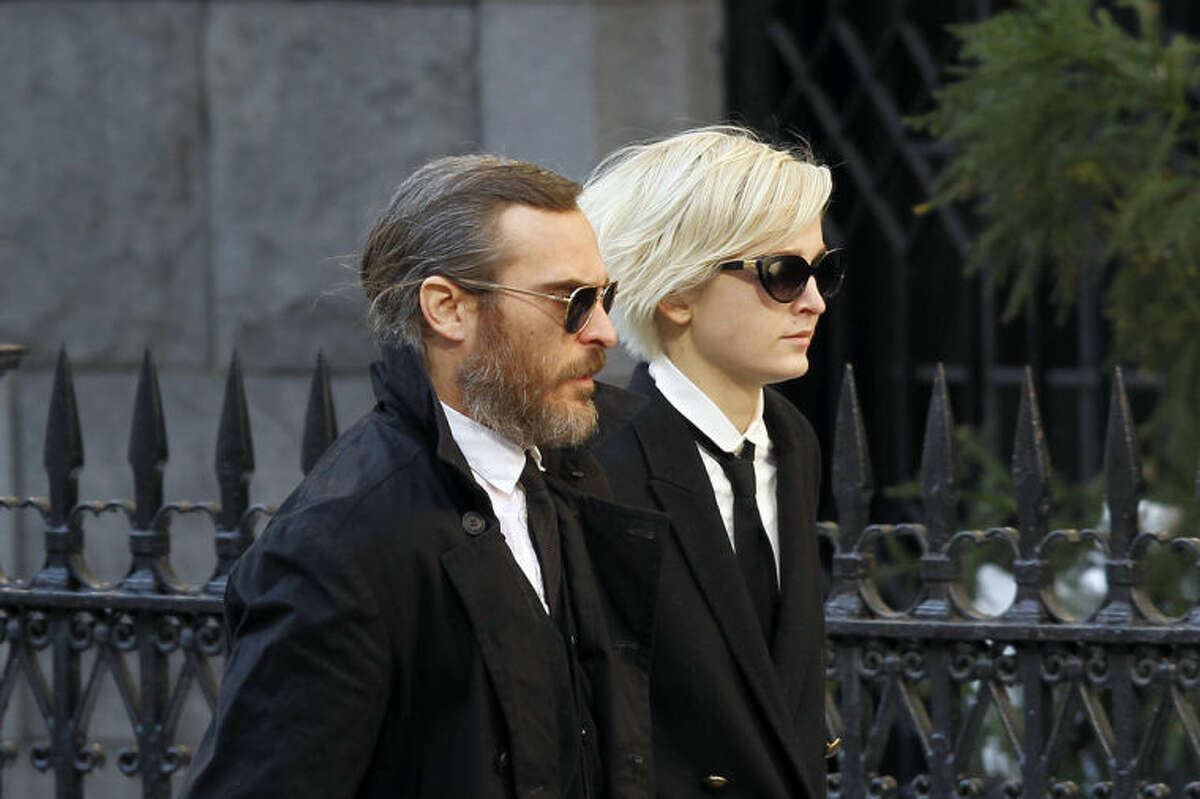 Actor Joaquin Phoenix arrives at the Church of St. Ignatius Loyola for the private funeral of actor Philip Seymour Hoffman Friday, Feb. 7, 2014, in New York. Hoffman, 46, was found dead Sunday of an apparent heroin overdose. (AP Photo/Jason DeCrow)