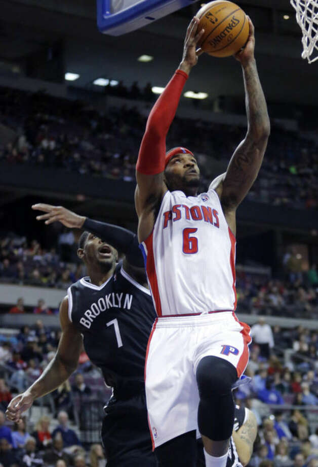 Detroit Pistons forward Josh Smith (6) gets past Brooklyn Nets guard Joe Johnson (7) for a dunk during the first half of an NBA basketball game on Friday, Feb. 7, 2014, in Auburn Hills, Mich. (AP Photo/Duane Burleson)