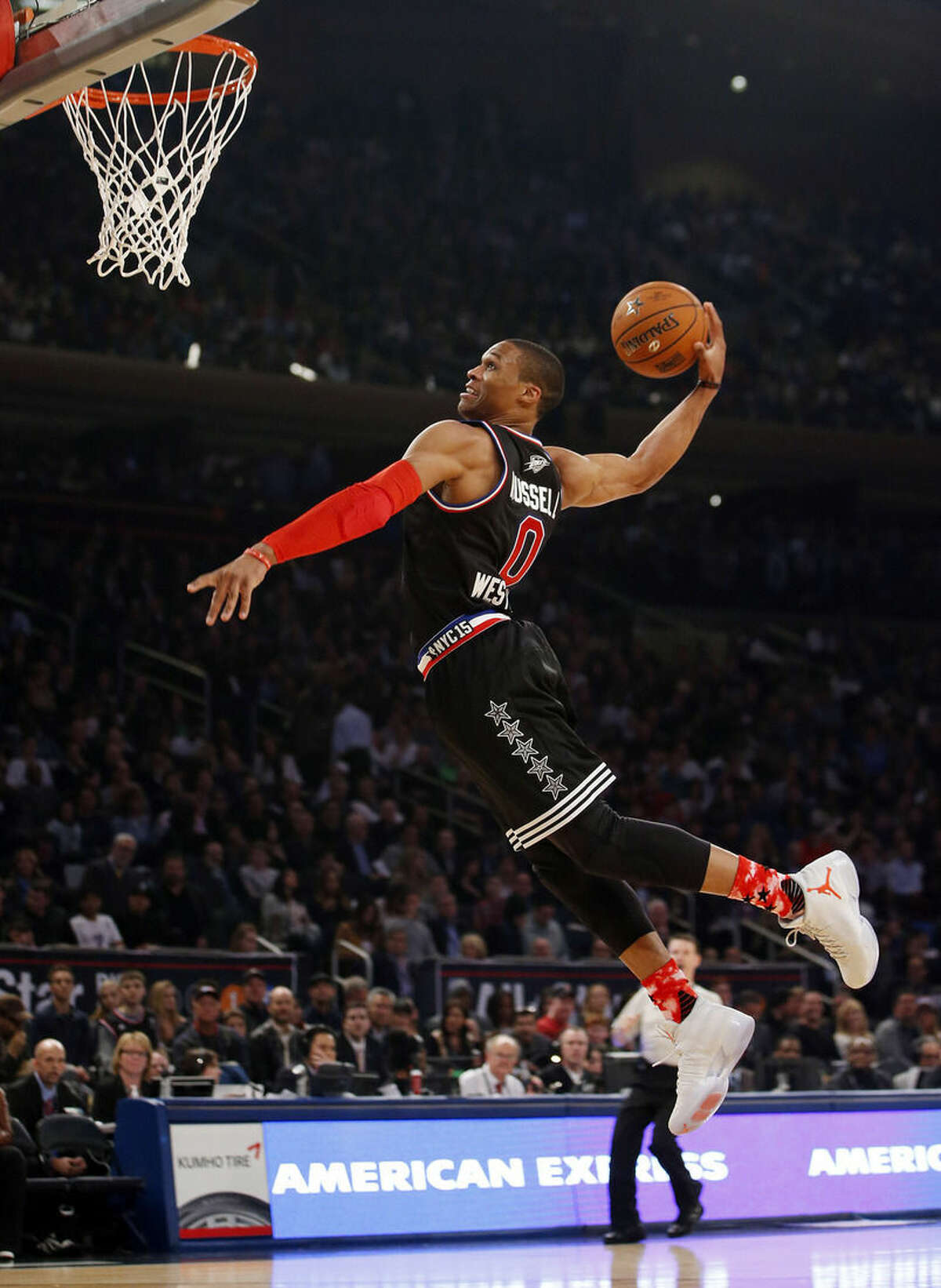 West Team's Russell Westbrook, of the Oklahoma City Thunder, dunks during the first half of the NBA All-Star basketball game, Sunday, Feb. 15, 2015, in New York. (AP Photo/Kathy Willens)