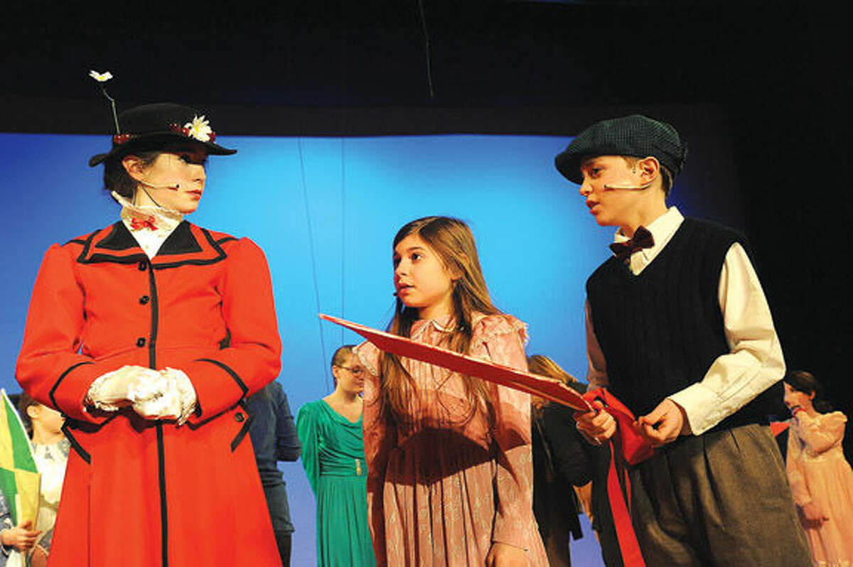 Daniella Sallese as Jane and Eli Foodman as Michael with Hailey Smith in the role of Mary Poppins in the Wilton Children's Theater's dress rehearsal at Middlebrook Middle School in Wilton.