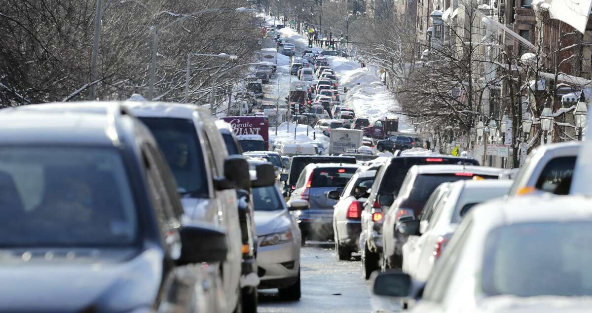 Cars are gridlocked on Beacon Street in Boston, Tuesday, Feb. 3, 2015. The Boston area has received about 40 inches of snow in the past week, causing significant traffic on the roads narrowed due to snow banks. (AP Photo/Charles Krupa)