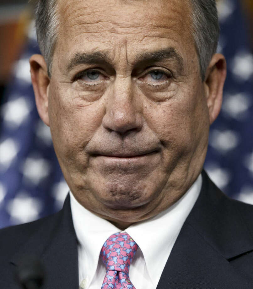 House Speaker John Boehner of Ohio pauses during a news conference on Capitol Hill in Washington, Thursday, Feb. 6, 2014. Boehner said Thursday it will be difficult to pass immigration legislation this year, dimming prospects for one of President Barack Obama's top domestic priorities. (AP Photo/J. Scott Applewhite)