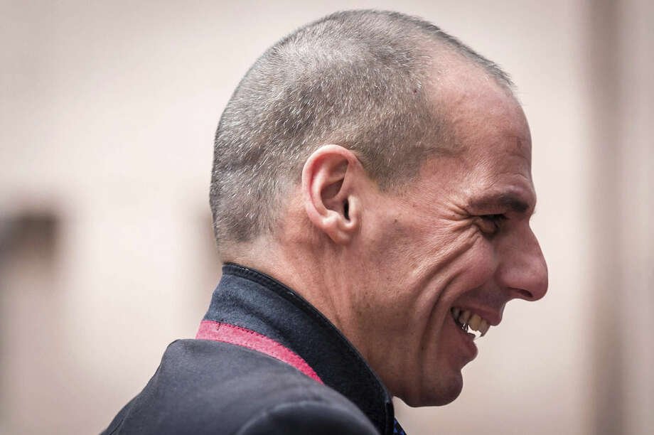 Greece's Finance Minister Yanis Varoufakis arrives for an Eurogroup meeting at the EU Council building in Brussels on Monday, Feb. 16, 2015. Greece's radical left government and its European creditors are heading into new talks Monday on the debt-heavy country's stuttering bailout program. (AP Photo/Geert Vanden Wijngaert)