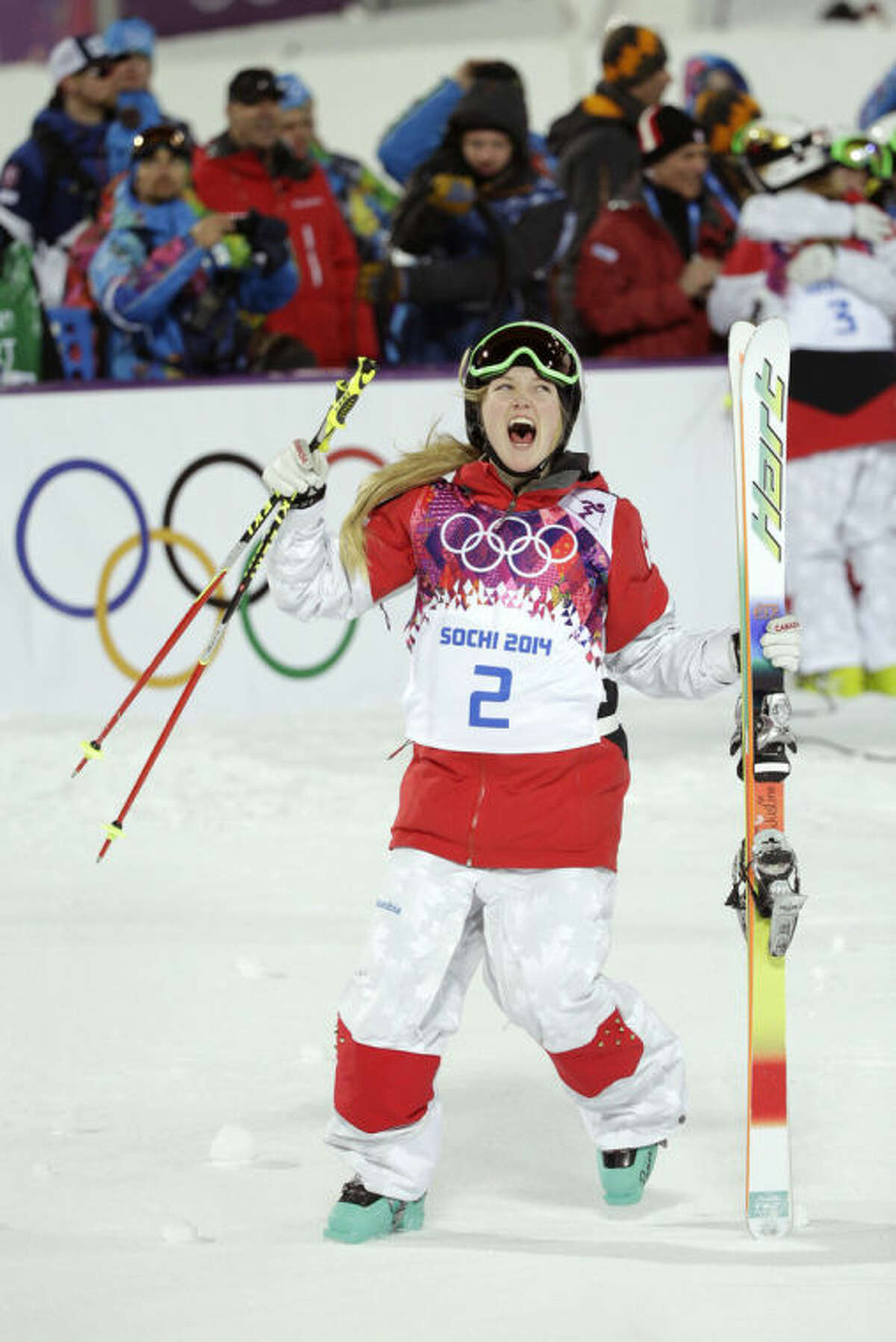 Canada's Justine Dufour-Lapointe celebrates after winning the gold medal final in the women's moguls at the 2014 Winter Olympics, Saturday, Feb. 8, 2014, in Krasnaya Polyana, Russia. (AP Photo/Jae C. Hong)