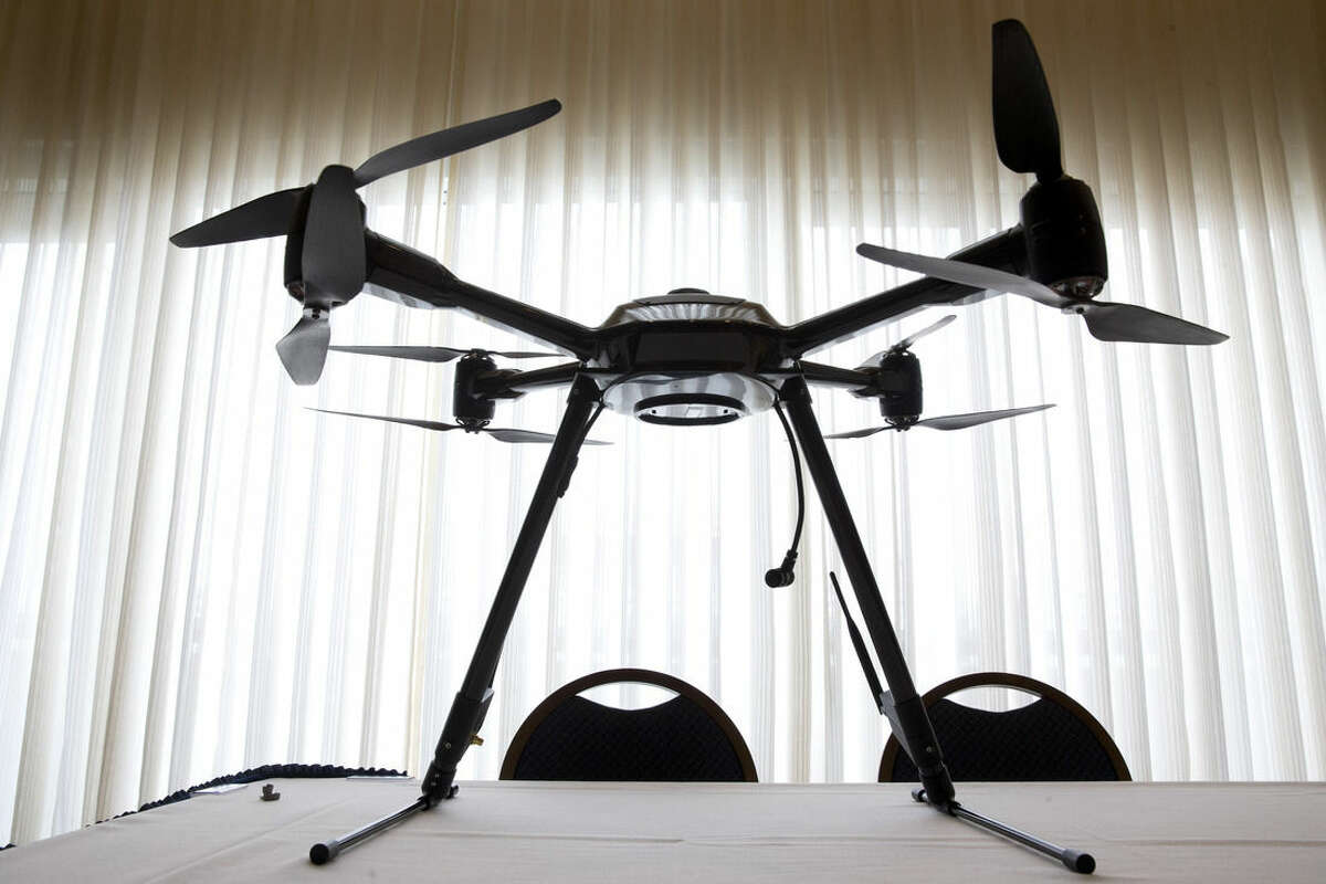 FILE - In this Jan. 20, 2015 file photo, the Aerialtronics Altura Zenith drone is seen at an event at the National Press Club in Washington. An economic analysis by the Federal Aviation Administration indicates the agency, citing economic and safety benefits, is seeking regulations largely favorable to companies that want to use small drones. The analysis, which was posted online, describes draft rules that would clear the way for widespread use of small drones for all manner of chores, including aerial photography, crop monitoring, and inspections of cellular towers, bridges and other tall structures. (AP Photo/Jacquelyn Martin)